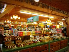 The Cabot Quechee Store (Quechee, VT) features a number of tasty products, from award-winning cheeses, to sweet jams, maple syrup, smoked meats, hot sauces and more. Our tours stop here to experience a little taste of Vermont. Check out the antique ice cream scoops along the top!