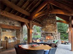 Covered Outdoor Kitchens and Patios | Cozy Transitional Outdoor Kitchen by Jerry Locati