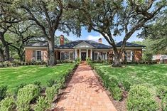 4901 Ridgeview Dr, Waco, TX 76710 | MLS #197704 | Zillow Brick Porch, Walker Zanger, Newport Brass, Gazebo Pergola, Live Oak Trees, Waco Tx, Oak Hardwood Flooring, Built In Ovens, Lush Garden