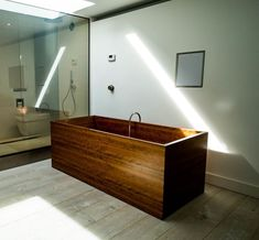 Private apartment in London. Freestanding wooden bathtub made in cherry wood.  #archilovers #bathroomdesign #custombathroom #custombathtub #freestandingbath #freestandingbathtub #homedecor #interiordesignblog #interiordesignmag #interiorspaces #luxurybathroomdesigns  #masterbathroom #modernbathroom #uniquewooddesign #woodenbathtub