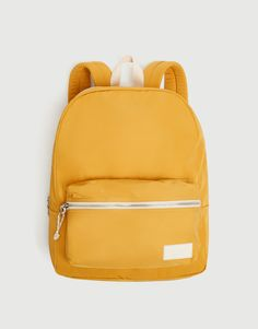 Yellow backpack with front pocket. Featuring a patch on the inside for personal details and zipper closure with reef knot zipper pulls. Prison Outfit, Yellow Backpack, Pikachu, Kagome Higurashi, Pull N Bear, Insulated Lunch Bags, Cute Backpacks, Travel Kits, School Bags