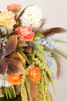 Boho-chic wedding bouquet with feathers and succulents
