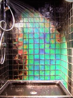 """""""Northern Lights Tile"""". Tiles appear black at room temp, but move through the color spectrum when the temperature changes.   www.bloomingmarketers.ws?pinnorthern"""
