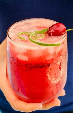 Sparkling Cherry Lime Cocktail is the perfect refreshing drink for summer! This is an adult spin on the classic Sonic Cherry Limeade. Filled with vodka, fresh cherries and lime juice, it's easy to make and tastes great! #alcohol #summerfun #cherryrecipes #limerecipes #vodka