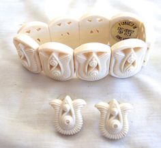 Vintage Avon set of matched earrings and bracelet in a tulip design. RetroRosiesVintage on Etsy.