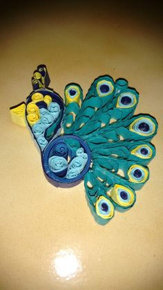 Quilled peacock hanging
