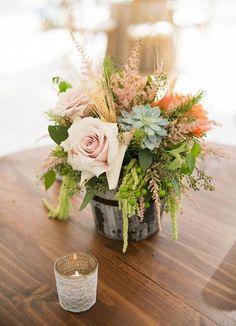 reception centerpieces flower centerpieces / http://www.himisspuff.com/rustic-wedding-centerpiece-ideas/4/