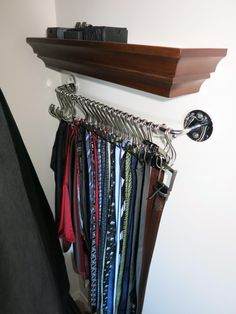 I need a way to organize and store my ties, belts, pocket squares, cufflinks, and tie clips, but there were few DIY solutions that I could find, so I came up with my own. I found almost all of the pieces at Walmart (they were the only store that seemed to have the pieces that worked together). I mounted this to the inside end wall in my closet. I don't have any suspenders, but this could also store suspenders. Make sure to visit the link to see how I made the different pieces work.