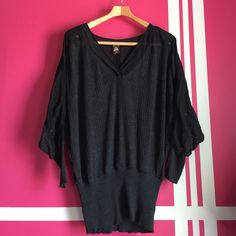 FREE PEOPLE  sheets loose knit top bat wing In okay used condition. There are some eyelets that are missing as you can see in the pictures and it has been through the washer and dryer many times. Made of cotton and silk, black in some lights, gray in other lights. Free People Tops