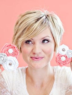 20 Cute Short Hair for Women | 2013 Short Haircut for Women; i have no idea whats shes doing with those flowers though