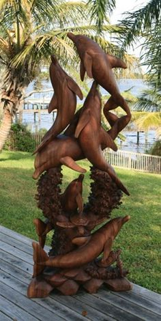 """Dolphin Swim"" wood carved art sculpture. please can we have this ridiculously marvelous artwork in our backyard pleaseee"