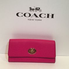 Coach SLM ENV wallet New, authentic Fuchsia Coach leather wallet with original tag. Coach representative informed me that this particular style is exclusive and has limited availability in store. Consists of 12 card compartments in addition to single large zip compartment inside. Includes detachable light pink pouch in the back. No trades. Low offers will be declined. Thank you! Coach Bags Wallets