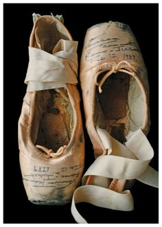 Well worn pointe shoes with notes