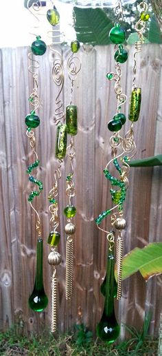 Bugger hanging the beads and crystals with fishing line! Simple wire makes it more decorative!