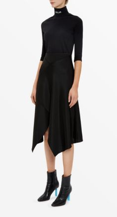 Shop now. Vetements Midi Asymmetric Skirt. This reissued VETEMENTS 1ST SEASON midi-length asymmetric skirt is crafted using the brand's hallmark spliced-together style. The fluid iris-blue fabric and diagonal panelling is pulled together with a jersey waistband.