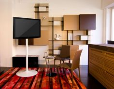 """Elio stand can support screens and monitors up to 42"""" 50"""" and 55"""" size. Featuring a clean cut and stylish design Elio stand will enhance existing furnishing, blending in with all surroundings, whether residential or commercial."""