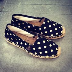 Black and white satin polkadot flat espadrilles.