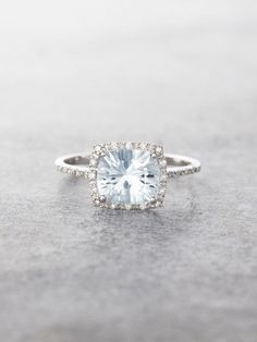 Sparkling and fancy, this gorgeous Starburst-cut Aquamarine Gem is flanked with a halo of shimmering brilliant cut Diamonds and set in stunning 14K Gold. Aquamarine measures approx. 7.5 mm x 6.5 mm, a #diamondhaloring
