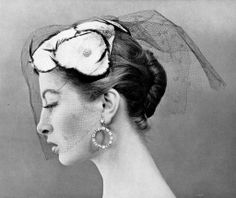 diamond hoops - Capucine in small cap adorned with feathers and sheer silk voilette by Claude St. Cyr, photo by Georges Dambier, 1954