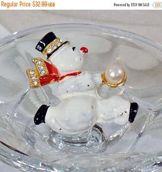 This #vintage Weiss snowman brooch is beautiful!  It features an adorable white enamel snowman with a black top hat and a red scarf, both accented with clear rhinestones.  I... #ecochic #etsy #jewelry #jewellery ➡️ http://jto.li/VpNSP