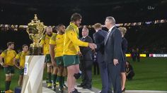 The Australian players receiving their runners-up medals after losing to New Zealand in the rugby World Cup final
