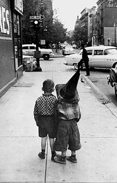 +~+~ Vintage Photograph ~+~+   Children playing on the street using a street cone for a hat. 1955 ~ N.Y.C.
