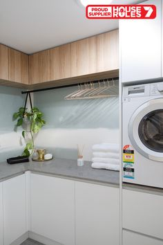 House Rules QLD laundry in polytec Natural Oak Ravine and Crisp White Legato.