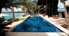 Aquatic Consultants, Inc./Brian Van Bower | Miami, Florida - Featuring an all-tile finish, this dazzling perimeter-overflow and vanishing-edge pool also includes an elevated perimeter-overflow spa. http://www.luxurypools.com/blog/entryid/116/the-2013-pinnacle-awards-winners.aspx