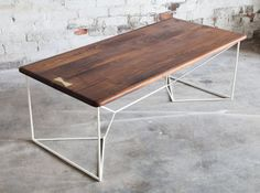 Brass Coffee Table, Coffee Table, Brass Accent , Geometric, Metallic, Gold Coffee Table,Modern Coffee Table,Walnut Coffee Table  New Design:  Looking for something a little more than your usual coffee table? We have you covered!  Stunning high grade Amish sourced black walnut with a brass bowtie key perched atop a steel powder rod coated base. Available with matte black and matte white base only. -1 Amish sourced FSC certified Black walnut tabletop.  -Solid steel powder coated steel rod…