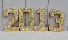 Spray paint and/or add glitter to numbers.  Great for New Years Eve or Graduation 2013 parties.