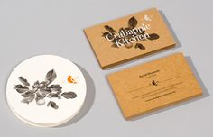 Coasters and business cards with traditional, botanical illustrative detail designed by Swear Words for high-end café/wine bar Crabapple Kitchen.
