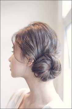 A low side chignon is romantic enough for an evening event.   21 Ridiculously Easy Hairstyles You Can Do With Spin Pins