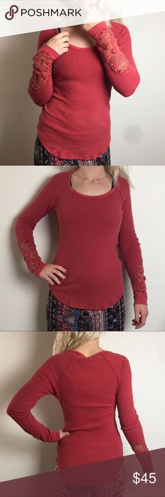 Free People sz. M red synergy cuff thermal top This cozy, classic Free People cuff thermal top is perfect for fall. Discontinued, hard-to-find style. Features crochet detailing at the cuffs, a rounded hemline, and a raw, exposed hem detailing. Runs smaller than other FP styles. Fabric content is (body): 51% cotton, 38% polyester, 5% spandex, (cuffs): 100% cotton. Made in China. In good used condition. Measurements in description. Free People Tops