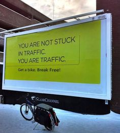 """""""You are not stuck in traffic. You are traffic."""" Someone handy with Photoshop subverted an advertisement (photo by: Carlton Reid http://www.flickr.com/photos/carltonreid/5260106747/ [Flickr]) for a satnav gadget into a call to ride bikes to work. The downside of that, obviously, is that you'd have to ride in snow (like the photo shows)."""