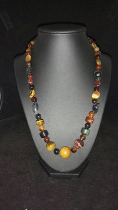 Check out this item in my Etsy shop https://www.etsy.com/listing/294892059/tiger-eye-onyx-and-jasper-necklace-20