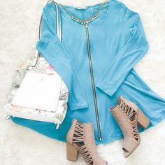 """Blue Zipper Top This cute tunic top has a zipped that goes all the way down the front and the bottom fm flares slightly like a peplum.{actual color of item may vary slightly from pics}  *shoulders:21"""" *chest:18.5"""" *waist:19"""" *length:27.5""""/sleeves:24""""  *material/care:95%rayon5%spandex•hand wash  *fit:stretchy might work for large  *condition:has two spots pictured on arm & next to side seam   20% off bundles of 3/more items No Trades  NO HOLDS No transactions outside of Poshmark  No lowball…"""