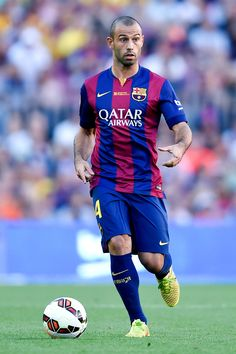Javier Mascherano of FC Barcelona runs with the ball during the La Liga match between FC Barcelona and Granada CF at Camp Nou on September 27, 2014 in Barcelona, Catalonia.