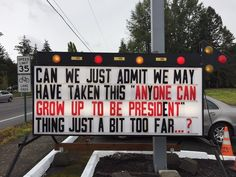 Give these sign makers a promotion, please.