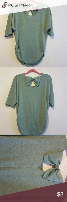 Cute shirt with back bow  Cute shirt with bow on back. Worn maybe twice, between a greenish and turquoise color. Can match with black jeans or anything you might want. Tops