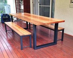 Steel hoop leg recycled messmate (eucalyptus) hard wood table and optional benche seats made to order in Australia (industrial meets timber) by UpcycledWoodOZ on Etsy could just paint wooden legs black Dining Table Sale, Timber Dining Table, Dining Table Design, Dining Table Chairs, Wood Table, Outdoor Dining, Patio Dining, Welded Furniture, Timber Furniture
