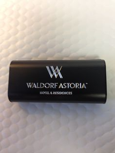 Waldorf Astoria Hotel and Residences. Custom engraved portable charger for all Waldorf Hotels and Resort guests to use during their stay.