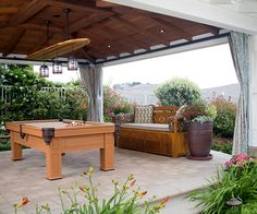 This outdoor billiard room and day bed are great tools for entertainment and relaxation. The curtains can be drawn together to create a private space, or be drawn back to let the breeze in. Try looking for weatherproof equipment to make sure your furniture can withstand natural elements from outside.
