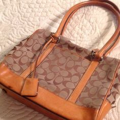 """Brown Signature Hampton Style Coach Handbag Purse Very good condition for being worn an entire season. Inside does have a small pen mark and could use a cleaning cloth wipe inside on bottom.  12"""" w x 10"""" h x 4 inch depth.  8 inch clearance from leather straps to handbag.  Does not come with dust bag.    30% off ALL BUNDLES!!!   Coach Bags Satchels"""