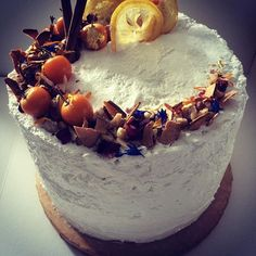 Cinnamon and almond cream layer cake. Decorated with apple crisps, physalis and cornflowers. Campbell & Love, London, England. Luxury confectionery. Bespoke desserts. enquiries@campbellandlove.com
