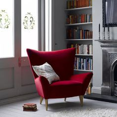 What about one red chair by the library area next to the desk?