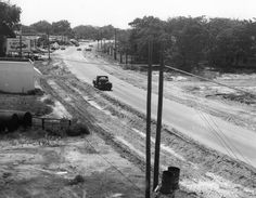 Eglin Parkway, Fort Walton Beach, while under construction, about 1940. Photograph courtesy of the Staff-Gerlach Family. The signs in the photograph read: Coleman Automatic Heating; Winning V8-Chevrolet, Gulfview Motor Company, Inc., Fort Walton Beach; Staff Restaurant-Cafeteria, 3 Blocks, Hotel, Cottages; Standard Oil;Texaco.