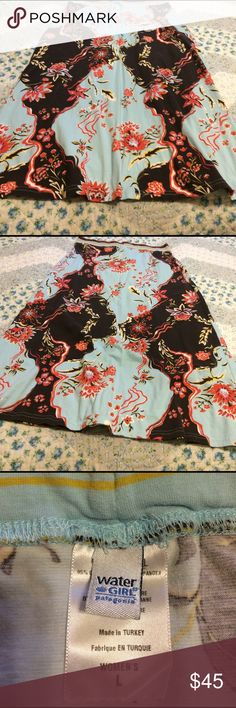 Patagonia 'Water Girl' Long Print Skirt EUC Patagonia 'Water Girl' series long print skirt. Soft organic cotton with a touch (5%) Spandex. Gorgeous tones of soft blue, chocolate brown, gold, rust and hot pink in the pattern. Approximately 34 inches from top of waist to bottom of hem. Looks great paired with vintage Patagonia jacket in my closet. Just sayin... Patagonia Skirts Maxi