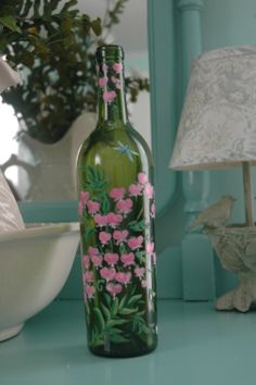 Here is a hand painted wine bottle that I did with pink bleeding heart flowers covering the bottle.  SOLD