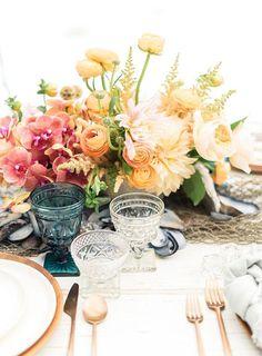 This garden-esque wedding centerpiece is just too dreamy.