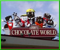 The Hershey's Chocolate World logotype represents that the company caters to a younger audience. The font, being in all caps helps people see it from farther away and the characters present on top of it not only symbolize the child- centered audience, but it also as appealing to adults as well.
